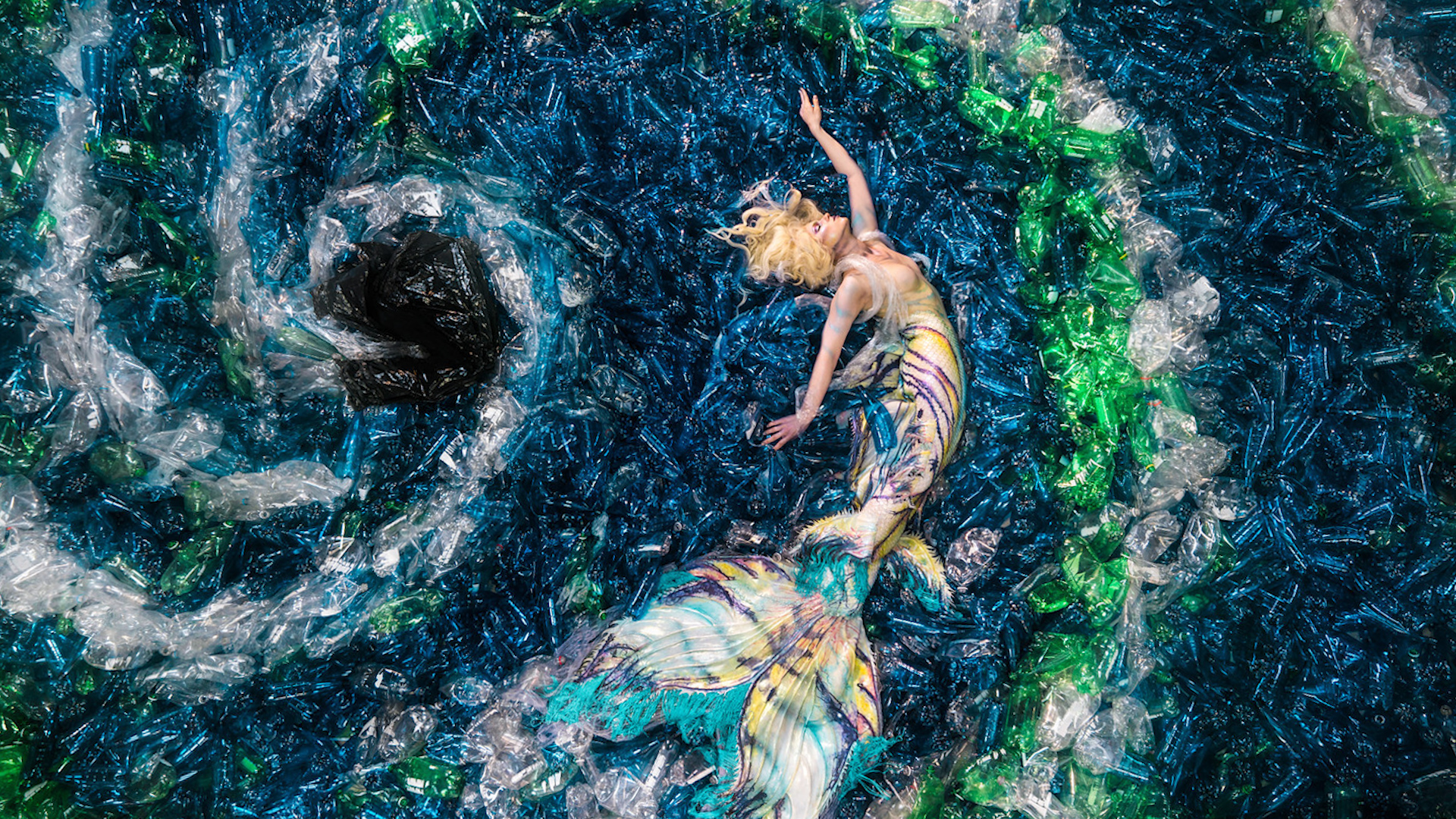 Canadian artist uses 10,000 plastic bottles for mermaid photo shoot to  raise awareness on waste