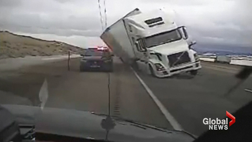 wind gust pushes tractor trailer onto police patrol car watch news
