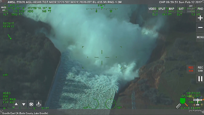 Water overflows from Oroville dam emergency spillway
