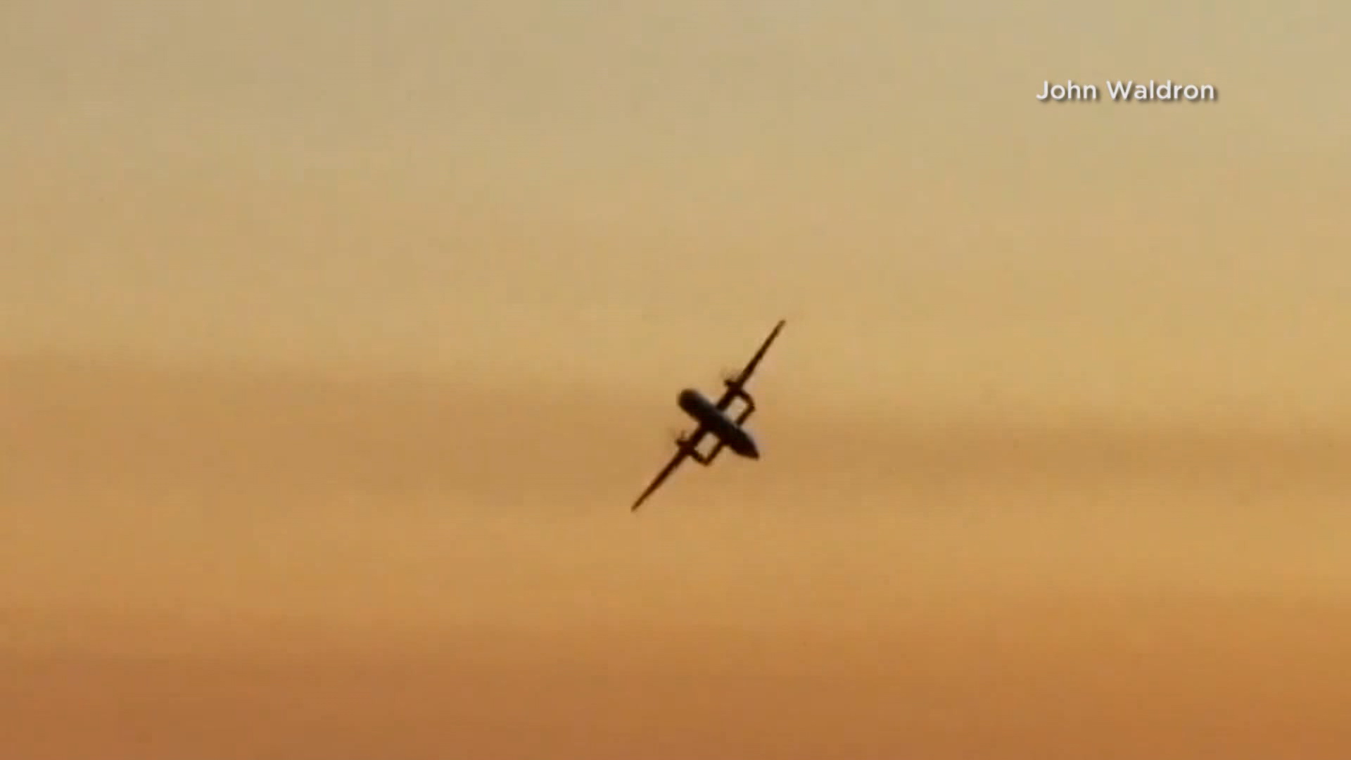Video shows plane flying with F-15 fighter jet following, before later  crashing